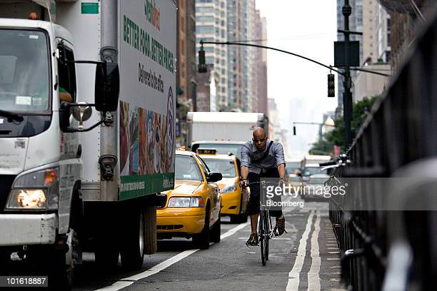 A bicyclist rides in a bike lane in New York US on Tuesday June 1 2010 Global bicycle production is set to outpace growth in automobile production as...