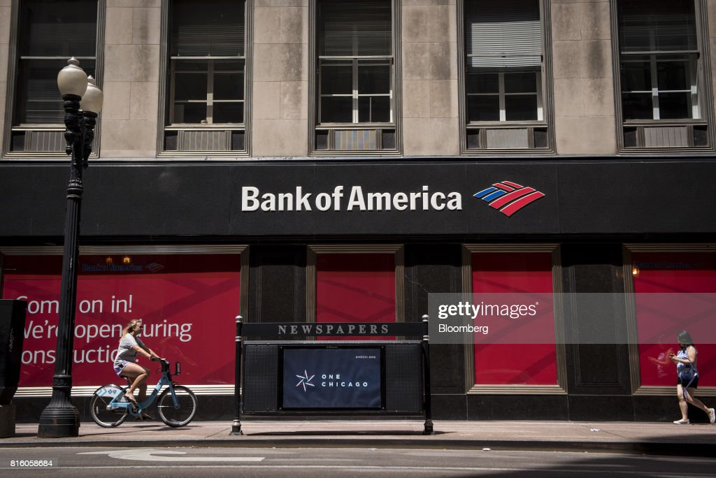 A bicyclist rides in front of a Bank of America Corp. building in Chicago, Illinois, U.S., on Sunday, July 9, 2017. Bank Of America Corp. is scheduled to release earnings figures on July 18. Photographer: Christopher Dilts/Bloomberg via Getty Images