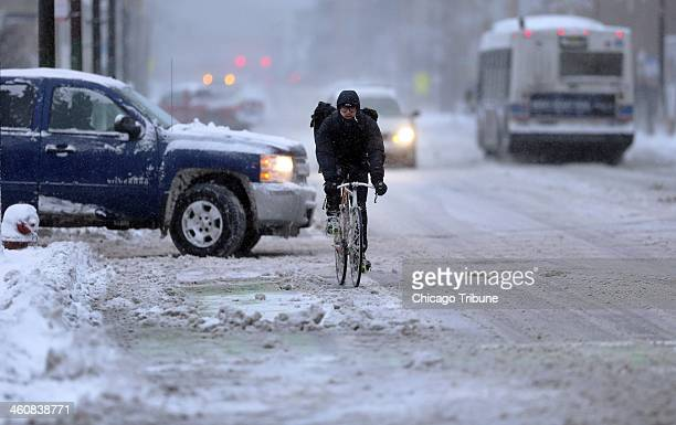 A bicyclist rides northbound on Milwaukee Avenue in Chicago on Sunday Jan 5 2014