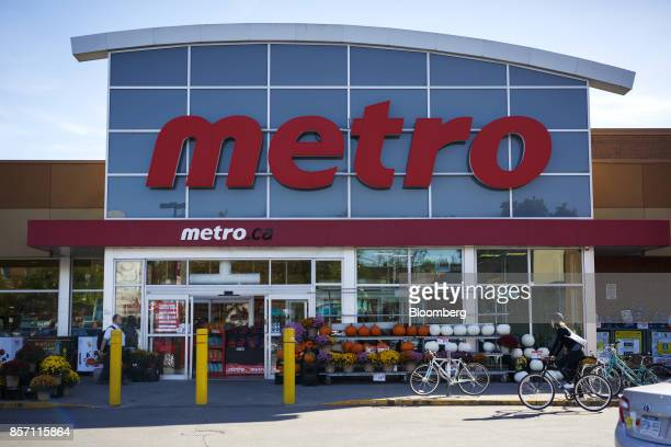 A bicyclist rides past a Metro Inc grocery store in Toronto Ontario Canada on Monday Oct 2 2017 Canadian grocer Metro Inc agreed to buy pharmacy...