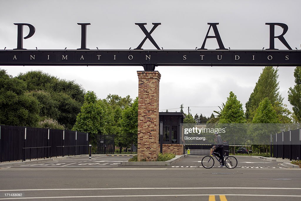 A bicyclist rides past the entrance to the Pixar Animation Studios headquarters in Emeryville, California, U.S., on Friday, June 21, 2013. Walt Disney Co.s Pixar animation 'Monsters University' took first place at U.S. and Canadian theaters this past weekend with $82 million in ticket sales, overcoming Brad Pitts zombie apocalypse tale 'World War Z,' which was second with $66 million. Photographer: David Paul Morris/Bloomberg via Getty Images