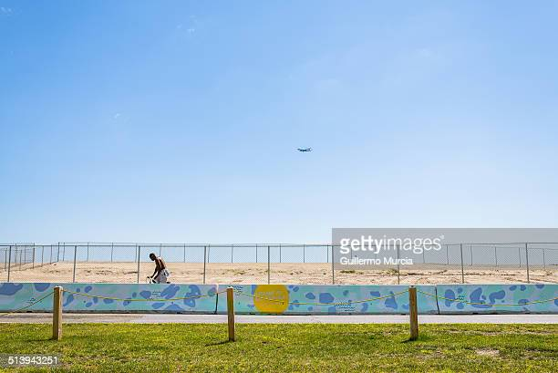 A bicyclist rides the temporary bike route at the Rockaway Beach in Queens New York Boardwalk still under reconstruction since Hurricane Sandy made...