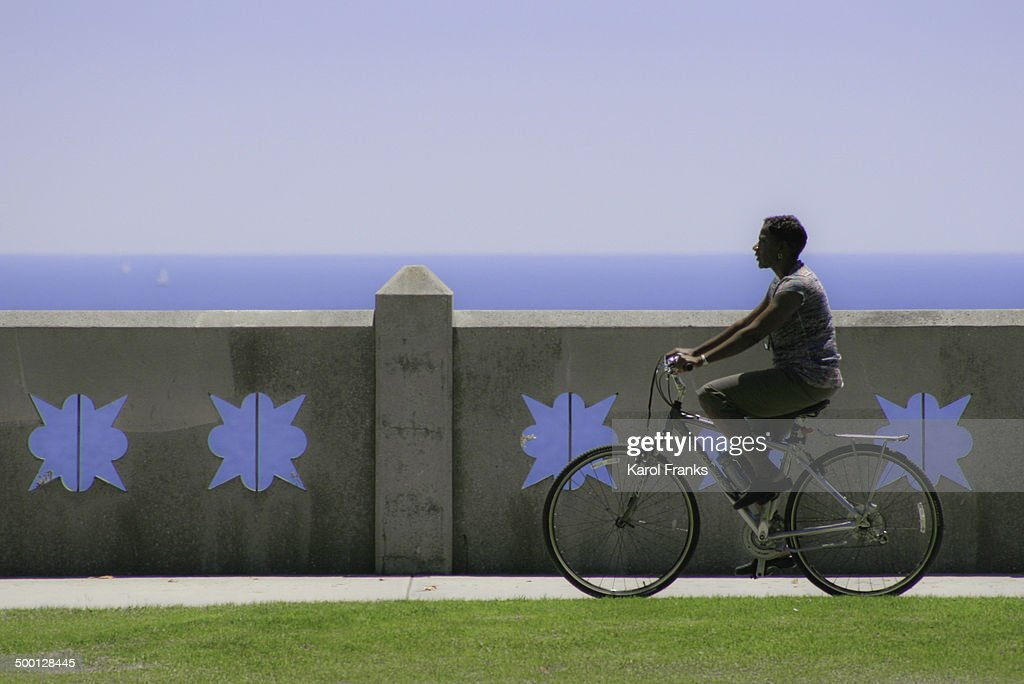 Bicyclist riding at the beach