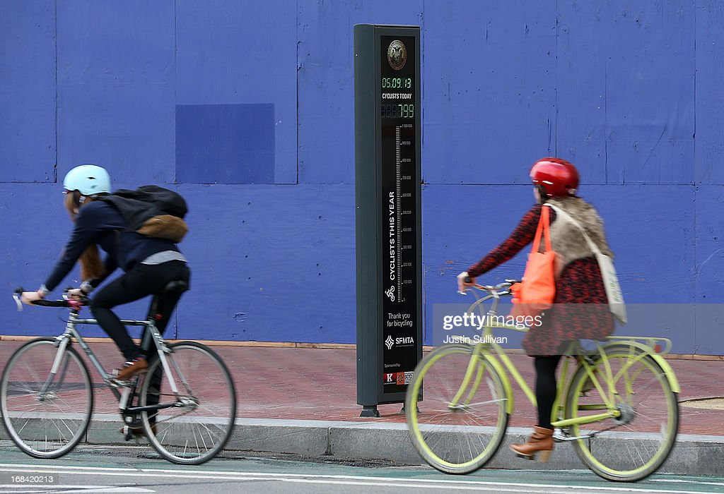 Bicyclists ride by an automated real-time bike counter on Market Street on May 9, 2013 in San Francisco, California. The San Francisco Municipal Transportation Agency has installed an automated real-time bike counter, also known as a bicycle barometer, on Market Street that will display daily and annual counts. According to the SFMTA, the number of cyclists on the streets of San Francisco has surged 71 percent between 2006 and 2011.