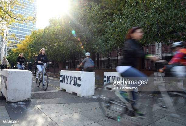 Bicyclists ride past cement barricades which were placed along the West Side Highway bike path on November 3 2017 in New York City Sayfullo Saipov an...