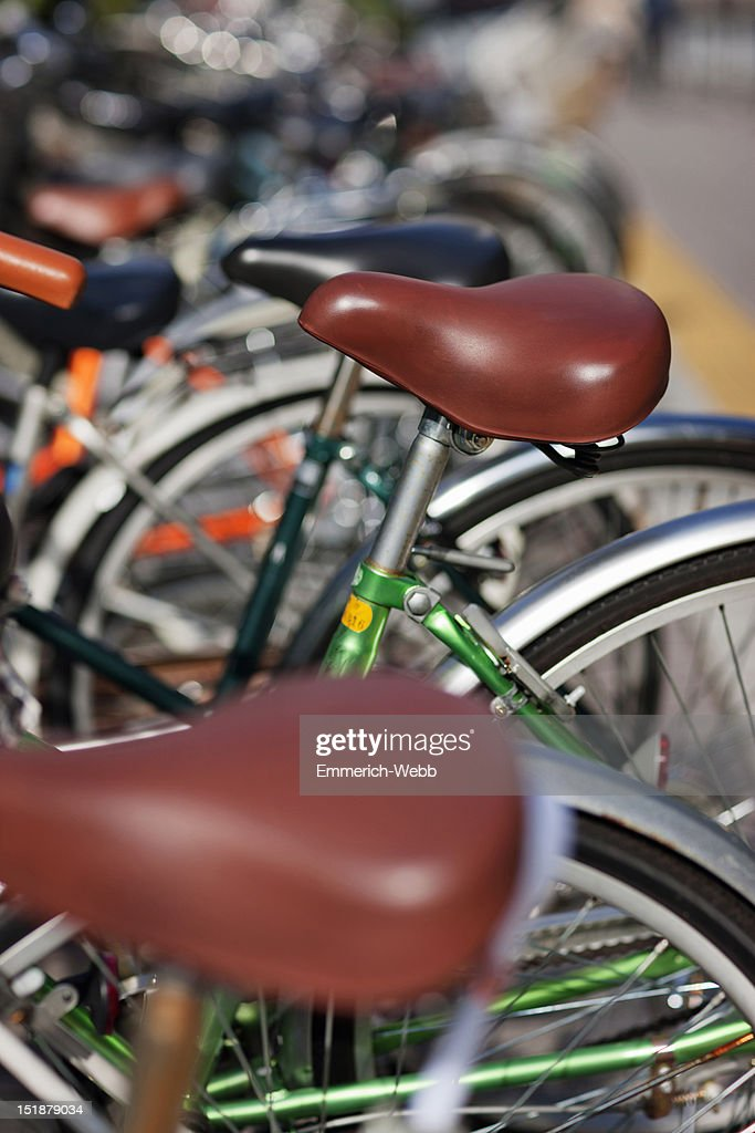 Bicyles parked in the city : Stock Photo