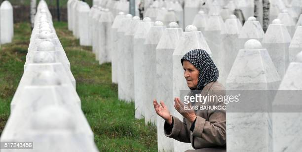 Bida Smajlovic a survivor of July 1995 massacre in Srebrenica prays by her husband's grave at a memorial center in Potocari on March 24 2016 Former...