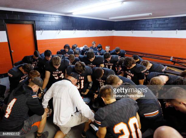 Biddeford hosts Westbrook in opener on Friday Biddeford players gather around head coach Brian Curit for pregame prayers before taking the field