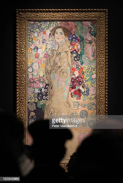 Bidders stand round Gustav Klimt's 'Frauenbildnis ' at Christie's on June 23 2010 in London England This work sold for £18250 $27055 during...