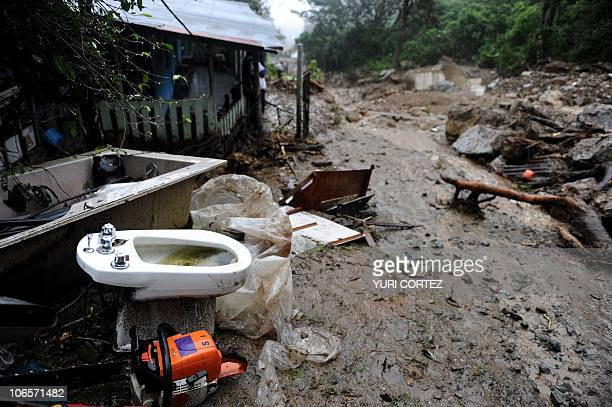 A bidet is seen in the area of a landslide at the Pico Blanco Hill in San Antonio de Escazu in Costa Rica on November 5 2010 A huge mudslide...