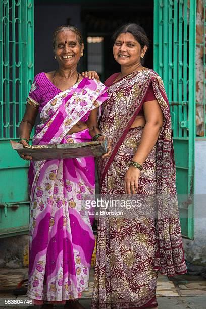 Bidi workers at home Rookmani Ram Naryan and her daughter Kavita Harshiresh Yemul make money hand rolling Indian style cigarettes called Bidi