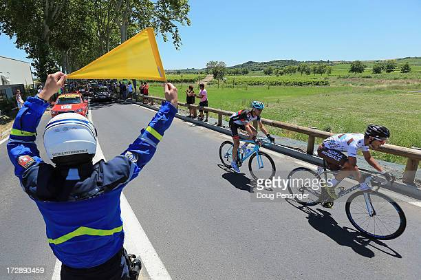 Biel Kadri of France riding for AG2RLa Mondiale leads Jens Voigt of Germany riding for RadioShack Leopard in the breakaway as a Gendarme shows a...