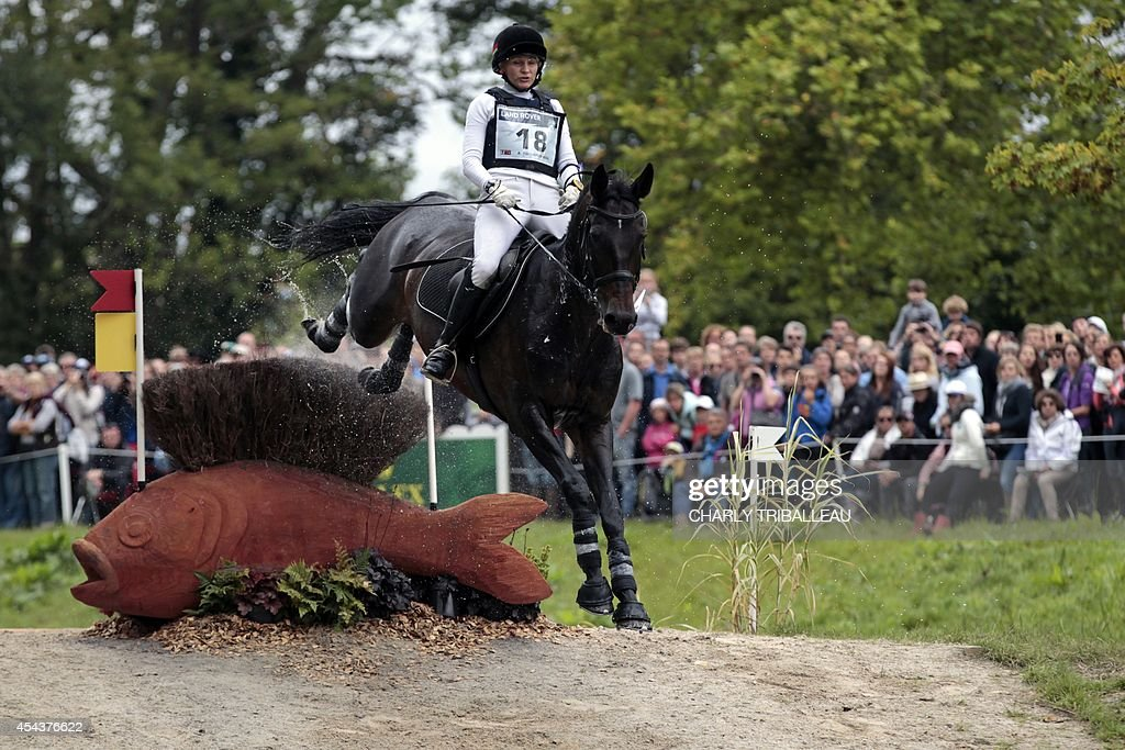 Bielorussian Alena Tseliapushkina rides Passat on August 30 2014 during the timetable crosscountry test of the 2014 FEI World Equestrian Games at the...