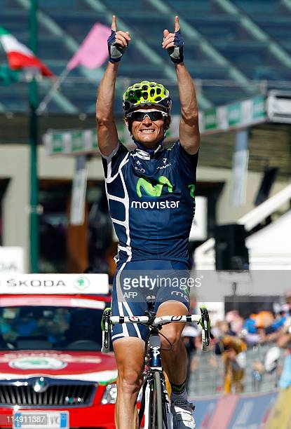 Bielorussia's Vasil Kiryienka rider with Movistar crosses the finish line in victory during the stage 20 of the 94th Tour of Italy run from Verbania...