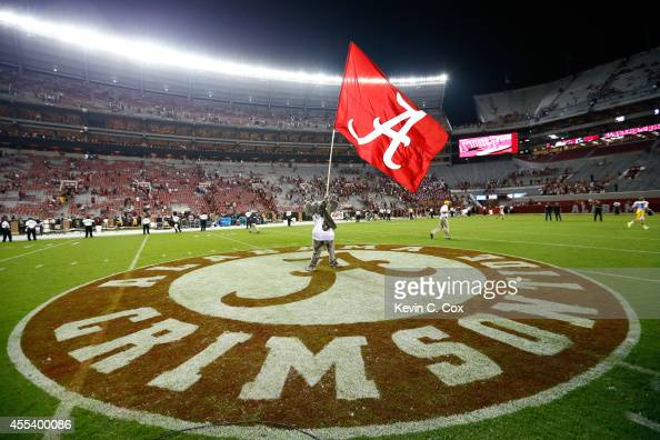 Big Al mascot of the Alabama Crimson Tide waves the flag after their 5212 win over the Southern Miss Golden Eagles at BryantDenny Stadium on...