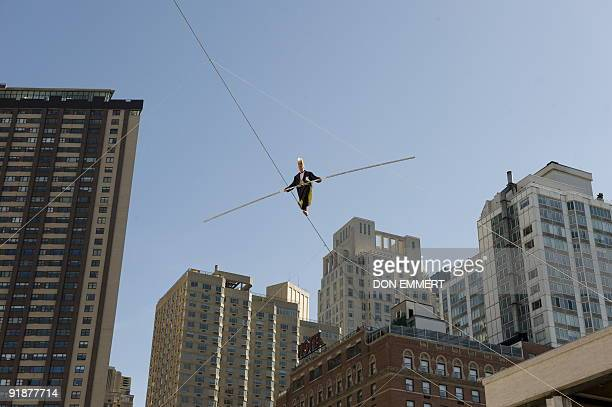 Big Apple Circus performer Bello Nock performs his highwire act over the fountain at Lincoln Center on October 6 2009 in New York The circus has an...
