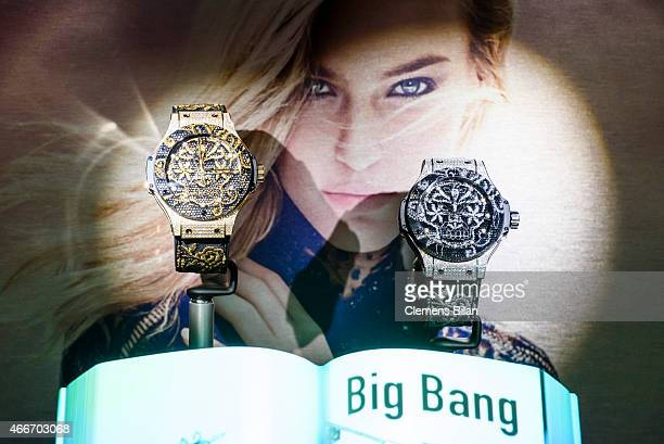Big Bang Broderie watches and an image of model Bar Refaeli are seen at the Hublot booth prior to a press conference to mark the 10th Anniversary of...
