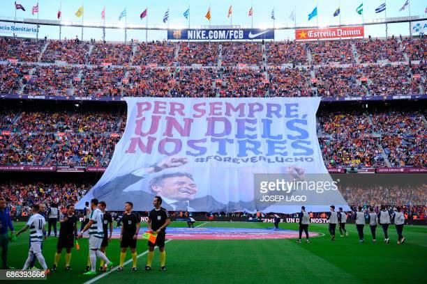 A big banner as a tribute to Barcelona's coach Luis Enrique reading in Catalan 'For ever one of ours' is unfolded before the Spanish league football...