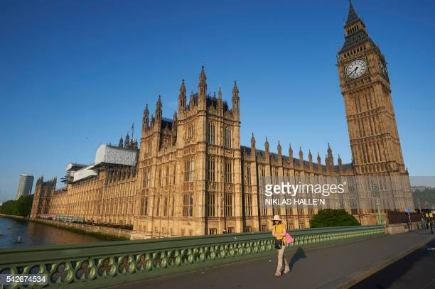 TOPSHOT Big Ben and the Houses of Parliament are bathed in morning sunlight in central London on June 24 2016 Britain has voted to break out of the...