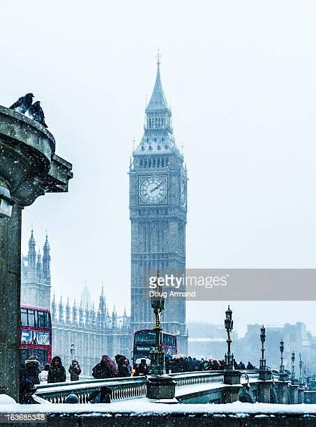 Big Ben and Westminster bridge in snow, London