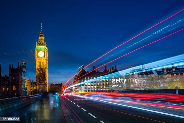 Big Ben at night with car light trails