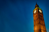 Closeup of Big Ben against the dark blue sky at night with copy space in Westminster, London, England, UK