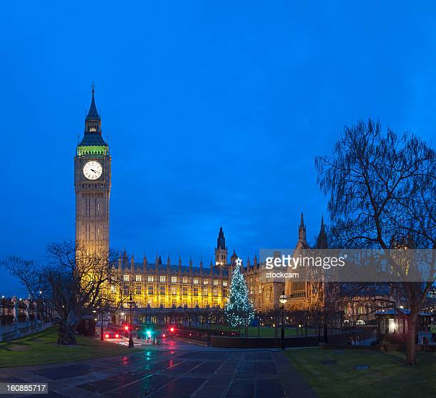 Big Ben in London with Christmas tree at dusk