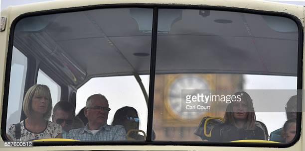 Big Ben is seen through the window of a tourist bus as passengers are driven on August 1 2016 in London England The UK's tourism industry is set to...