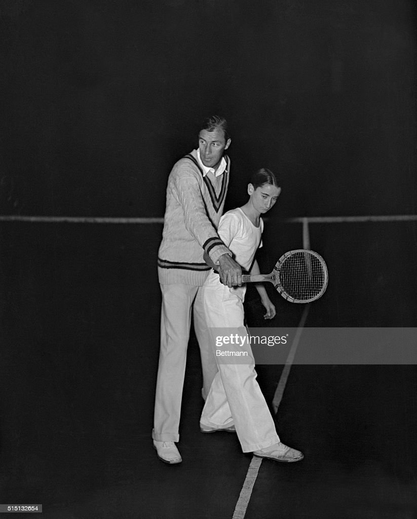 Bill Tilden Teaching Tennis to Junior Star