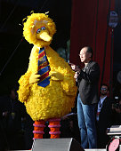 Big Bird and World Bank President Jim Yong Kim speak during the 2015 Global Citizen Festival at Central Park on September 26 2015 in New York City