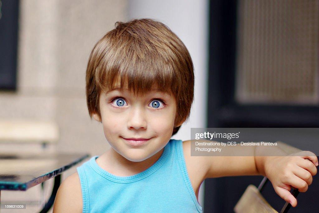 Big blue eyes boy : Stock Photo