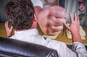 Big Boss Fist Slamming Down on Male Worker Desk - Work Stress Pressure Series.