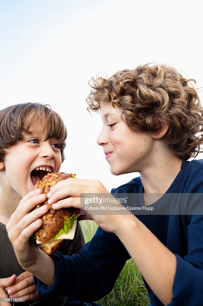 Big brother feeding little brother