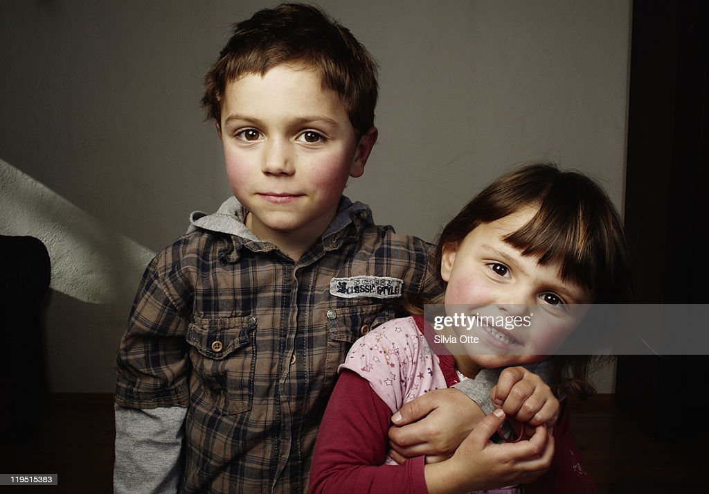 big brother hugging little sister : Stock Photo