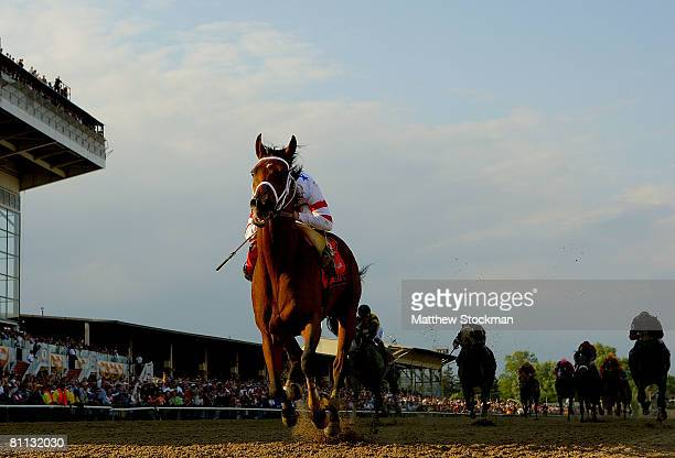 Big Brown ridden by Kent Desormeaux crosses the finish line to win the 133rd Preakness Stakes at Pimlico Race Course May 17 2008 in Baltimore Maryland