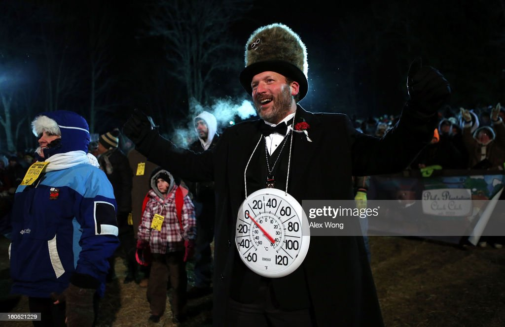 'Big Chill' Jason Grusky, a member of the Punxsutawney 'Inner Circle,' gestures during the 127th Groundhog Day Celebration at Gobbler's Knob on February 2, 2013 in Punxsutawney, Pennsylvania. Thousands of people gathered at the event to watch Punxsutawney Phil's annual forecast.