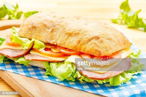 Big Ciabatta Sandwich with Bacon, Lettuce, Tomato, Cheese : Stock Photo