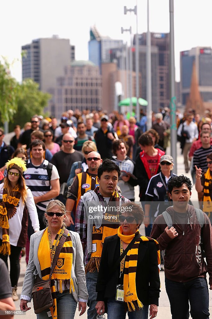 A big crowd arrives for the round one AFL match between the Hawthorn Hawks and the Geelong Cats at the Melbourne Cricket Ground on April 1, 2013 in Melbourne, Australia.