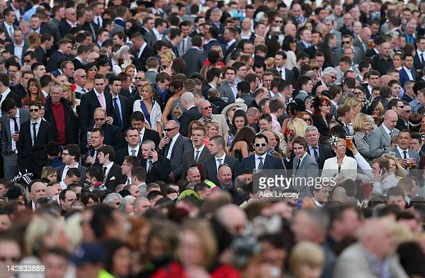 Big crowds of racegoers are seen during Ladies' Day at Aintree Racecourse on April 13 2012 in Liverpool England