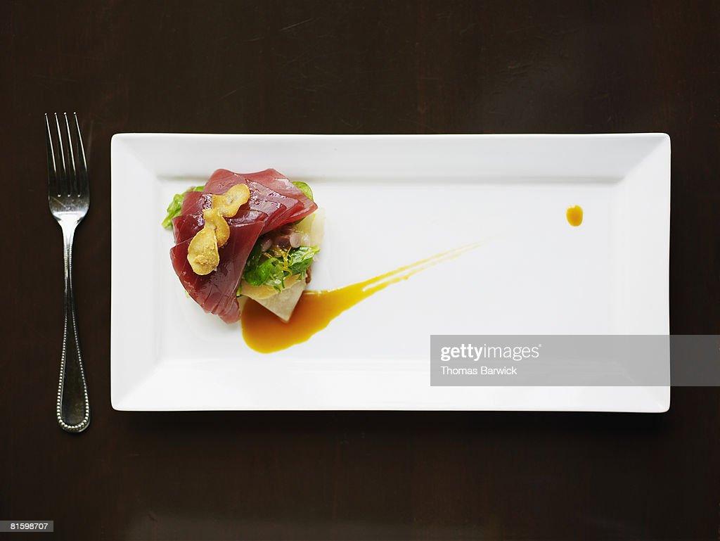 Big eye tuna tartare with crenshaw melon, brioche, orange reduction, mache and garlic chips