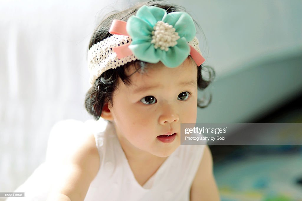 Big eyes of little girl : Stock Photo
