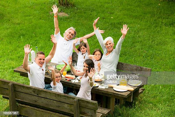big family having a picnic in the garden