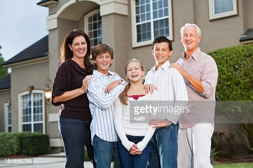 Big family standing outside house