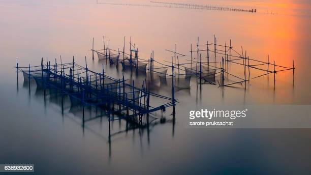 Big fishnet , coop fish, trap fish and  sunrise Thailand.
