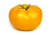 Big fresh yellow tomato isolated on white background.