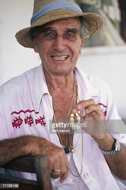 Big game hunter Bunny Allen in the Lamu Archipelago of Kenya February 1987 Around his neck he wears the teeth of a leopard which once attacked him