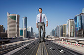 Big giant businessman walking in Dubai
