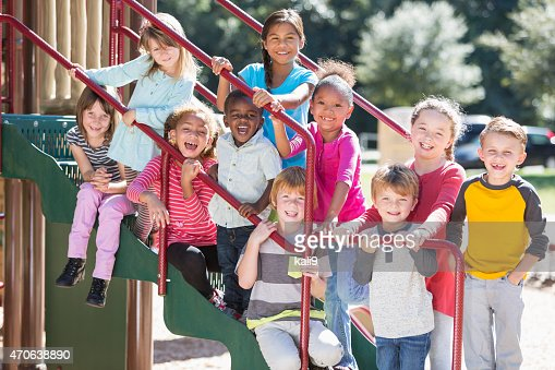 Big group of multi-ethnic children on a sunny playground