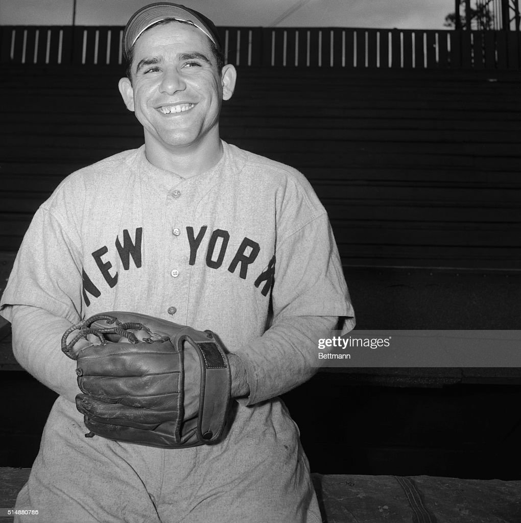 Big guns are no novelty to the New York Yankees, where heavy hitters are the rule.But this year manager Bucky Harris is happy at having Yogi Berra in his lineup. Berra seems to be no less happy as he shows his ivories in a broad grin here. The reason for all the hapiness is Yogi's impersonation of a bazooka. In 12 times at bat in the past two games, he has belted out 8 hits, including 3 homers and a double, while driving in 11 runs.
