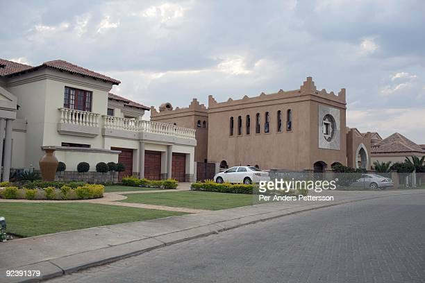Big houses stand at Phakalane private golf estate on September 22 2009 in central Gaborone Botswana Debswana a 50/50 partnership between the De Beers...
